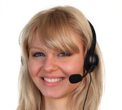 Woman working on in Customer Service. Woman working on a hotline at a customer service department Royalty Free Stock Images