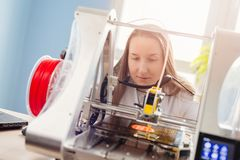 Woman working with 3d printer royalty free stock images