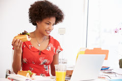 Woman Working In Design Studio Having Lunch At Desk Royalty Free Stock Photography