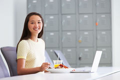 Woman Working In Design Studio Having Lunch At Desk Royalty Free Stock Image