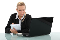 Woman working at a desk Stock Photography