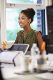 Woman Working At Desk In Contemporary Office Stock Photos
