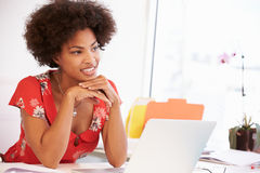 Woman Working At Desk In Design Studio Royalty Free Stock Photography