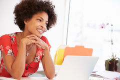 Woman Working At Desk In Design Studio Stock Photography
