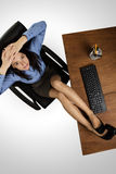 Woman working at desk shot from above Stock Photography