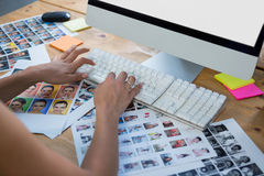 Woman working on desktop pc. Woman typing on keyboard at desk in office Royalty Free Stock Photos