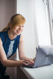 Woman working with the device 2 in 1 ultrabook. Woman working with the 2 in 1 ultrabook Royalty Free Stock Images