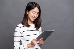 Woman working on digital tablet. Asian young woman Royalty Free Stock Image