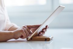 Woman working on a digital tablet. In the office royalty free stock images