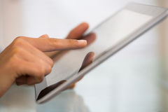 Woman working with digital tablet pc. Close-up hands female using tablet pc.indoor Royalty Free Stock Photos