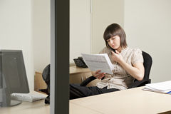 Woman working with documents Stock Photography