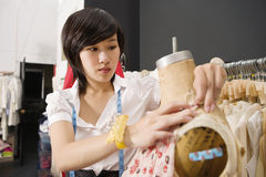 Woman working on dressmaker's dummy royalty free stock photography