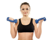 Woman working with dumbbells Royalty Free Stock Images