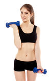 Woman working with dumbbells Stock Image
