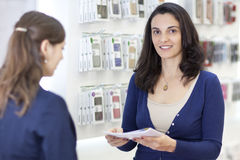 Woman working in an electronics store Royalty Free Stock Images