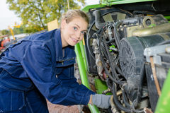Woman working on engine industrial machine Royalty Free Stock Photography