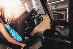 Woman working exercise on training apparatus in club Stock Photography