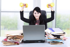Woman working and exercising in office Stock Photography