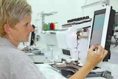 Woman working in a factory Royalty Free Stock Image