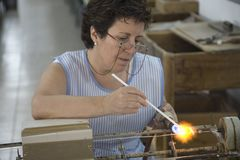Woman working on famous pearls of Majorca, the largest island of Spain, Europe on the Mediterranean Sea and part of Balearic Islan Royalty Free Stock Photography