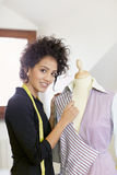 Woman working in fashion design studio Stock Photo