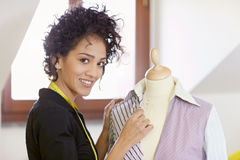 Woman working in fashion design studio Stock Image