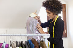 Woman working in fashion design studio Royalty Free Stock Images