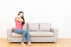 Woman working fatigue everyday feeling neck pain. And performed uncomfortable painful expression on sofa with wooden floor on white background Royalty Free Stock Photos