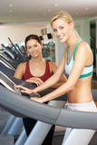 Woman Working With Female Personal Trainer. On Running Machine In Gym Royalty Free Stock Photos