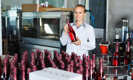 Woman  working on final section of wine production on factory Stock Photography