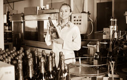 Woman  working on final section of wine production on factory Stock Images
