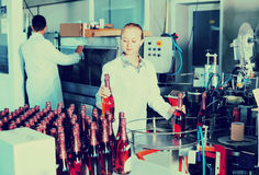 Woman  working on final section of wine production on factory Royalty Free Stock Images