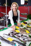 Woman working in fish store royalty free stock photos
