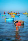 A woman working at fishing village in Cam Ranh bay, Vietnam Royalty Free Stock Images