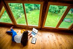 Woman working on the floor in wooden house Royalty Free Stock Photos