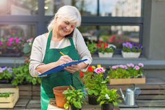 Woman working in florist shop Stock Images