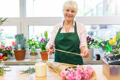 Woman working in florist shop Royalty Free Stock Images