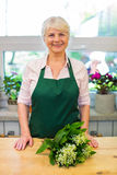 Woman working in florist shop Royalty Free Stock Photography