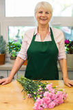 Woman working in florist shop Royalty Free Stock Photo