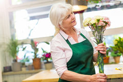Woman working in florist shop Stock Image