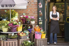Woman working at flower shop smiling royalty free stock image
