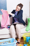 Woman working and folding clothes Stock Image