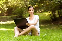 Woman working freelance.doing work in the park Stock Photo