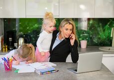 Free Woman Working From Home And Being With Children Royalty Free Stock Images - 185989369