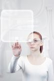 Woman working with futuristic interface. In laboratory Stock Photos