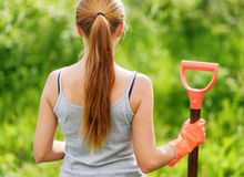 Woman working in the garden Stock Image