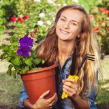 Woman working at garden Royalty Free Stock Images