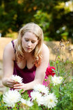 Woman working in the garden with flowers Royalty Free Stock Photo