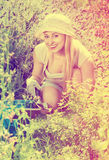 Woman working in garden using horticultural instruments on summe. Happy young  smiling woman working in garden using horticultural instruments on summer day Royalty Free Stock Images