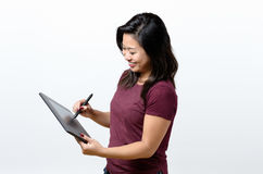 Woman working with a Grafic Tablet royalty free stock photos